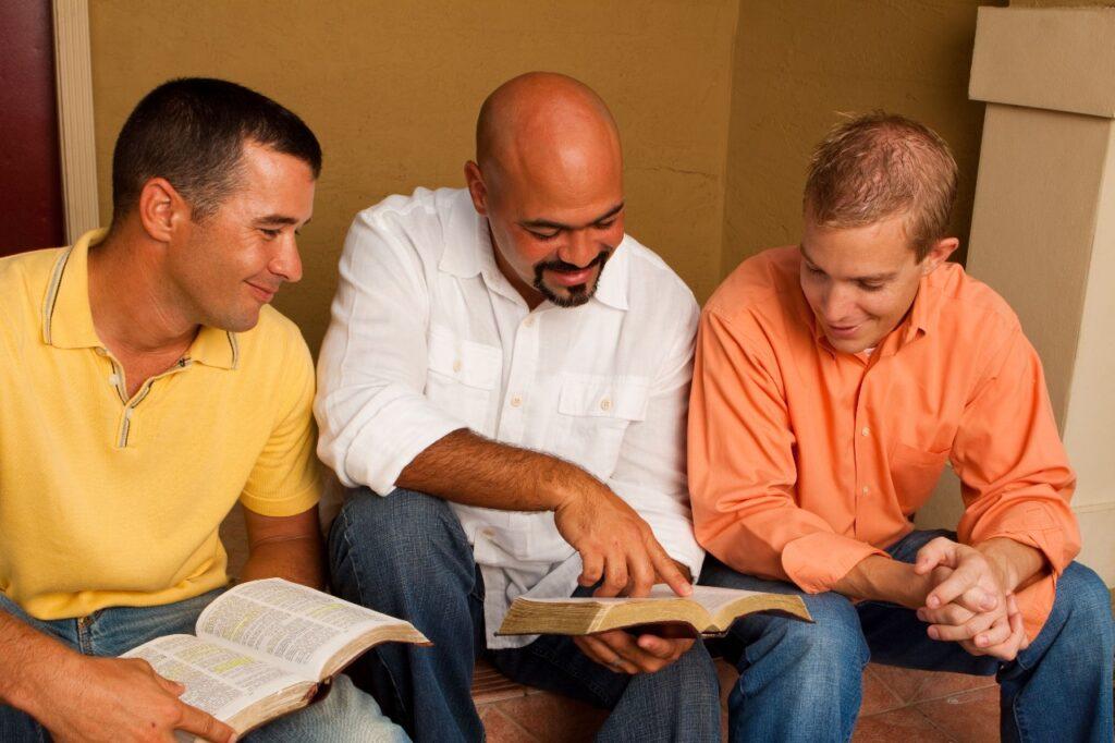 Men reading scriptures together